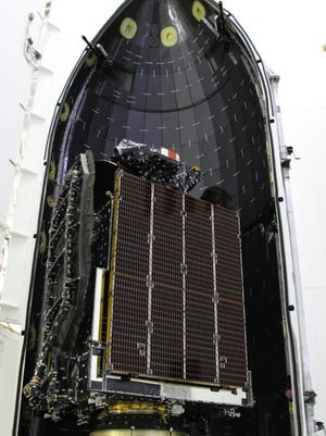The AsiaSat 6 commercial communications satellite was encapsulated in a payload fairing.
