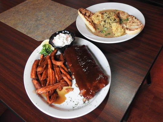 The smoked ribs with sweet potato fries and coleslaw (left) and the seafood etoufee with rice pilaf and fried oysters are among the dishes available at Muddy Misers.