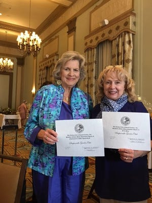 Marsha Alexander, Past President of the SC State Garden Club presents awards certificates to Judy Rogers President of the Simpsonville Garden Club