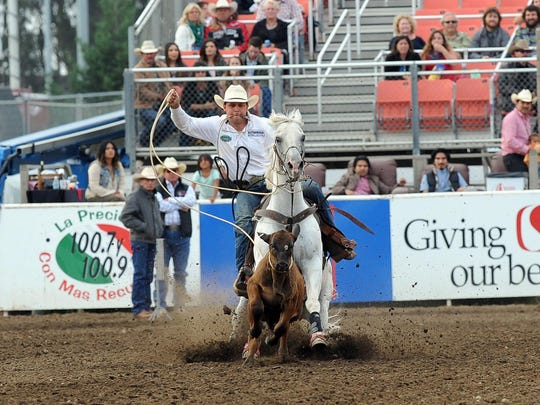 Michael Perry from Bandera, TX competes in the tie-down roping event on Friday night at the 2015 California Rodeo Salinas.