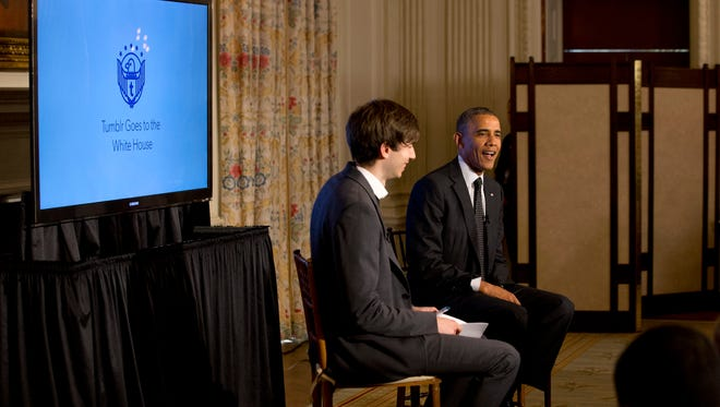President Barack Obama answers questions during a Tumblr forum from the State Dining Room of the White House in Washington on June 10, 2014, moderated by Tumblr Founder and CEO David Karp.