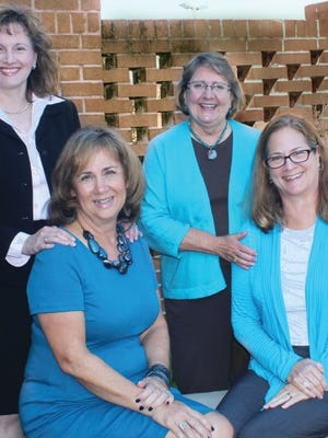 From left to right: Susan Payne Turner, Pam Butler, Pamela Aveling and Beth Tedio, discuss their role working with TCC Foundation.