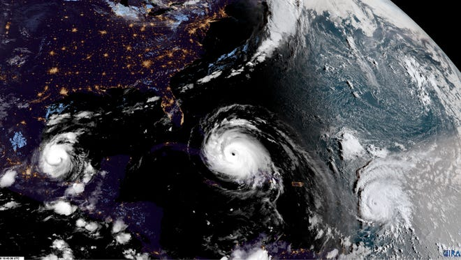 In this GOES-16 satellite image taken Friday, Sep. 8, 2017, at 10:45 UTC, Hurricane Irma, center, approaches Cuba and Florida, with Hurricane Katia, left, in the Gulf of Mexico and Hurricane Jose, right, in the Atlantic Ocean. Cuba evacuated tourists from beachside resorts, and Floridians emptied stores of plywood and bottled water after Hurricane Irma left at least 20 people dead and thousands homeless on a devastated string of Caribbean islands and spun toward Florida for what could be a catastrophic blow this weekend.
