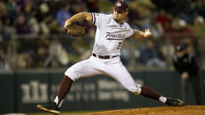 Texas A&M's Asa Lacy (35) throws a strike against a Miami (Ohio) batter during a game Feb. 14 in College Station, Texas. Lacy, who was recently selected in the first round of the MLB Draft by the Kansas City Royals, signed with the club this week.