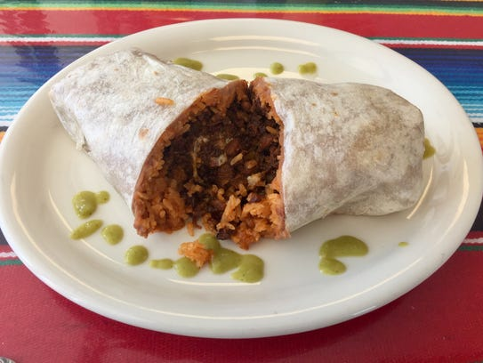 Beans and rice join pastor in a burrito at Carmelita's