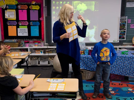 First-grader Joel Whelan, right, stands next to his