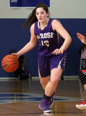 Jess Louro of St. Rose drives on Long Island Lutheran's Boogie Brozoski, Sunday, January 25, 2015, at the Coaches Choice Challenge tournament in Holmdel, NJ.