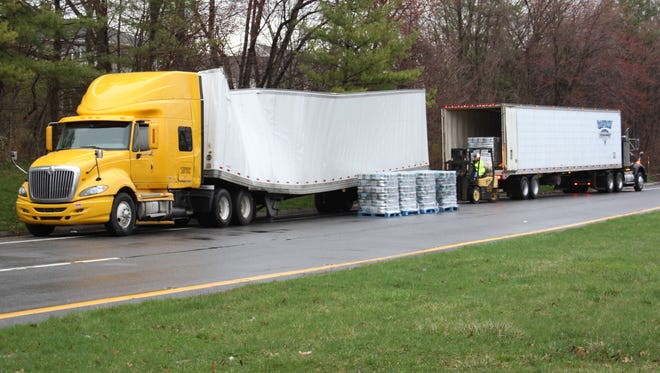 The damaged tractor trailer that got stuck under the Mamaroneck Road bridge in the early morning on Friday, April 17, 2015. Its cargo, reportedly bottled water, was loaded onto another truck.