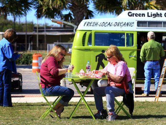 Judy Benavides (left) and Mel Glenn eat lunch during the Food Truck Fridays on Friday, Jan. 29, 2016, at the North Bayfront Park  in Corpus Christi. People had the chance to enjoy the weather, play games and listen to live music.