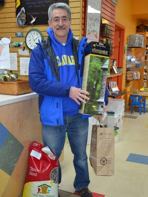 Mark Hummel of Marlton stocks up on bird feeding supplies at Wild Birds Unlimited, 1619 N. Kings Hwy., Cherry Hill.