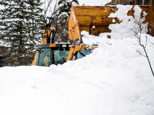 A tractor clears snow on Clark Street in Stevens Point,