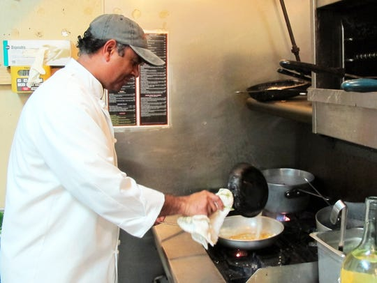Rohan Moxam, the new executive chef at Café Blu, prepares