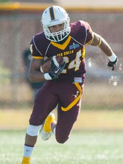 Salisbury slotback Aarron Moore looks for his next move in the open field against Brockport at Sea Gull Stadium in 2014.