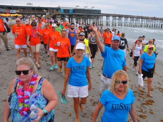 In a May 2017 photo, hundreds show their support for the National Kidney Foundation of Florida Footprints in the Sand Kidney Walk at the Cocoa Beach Pier.