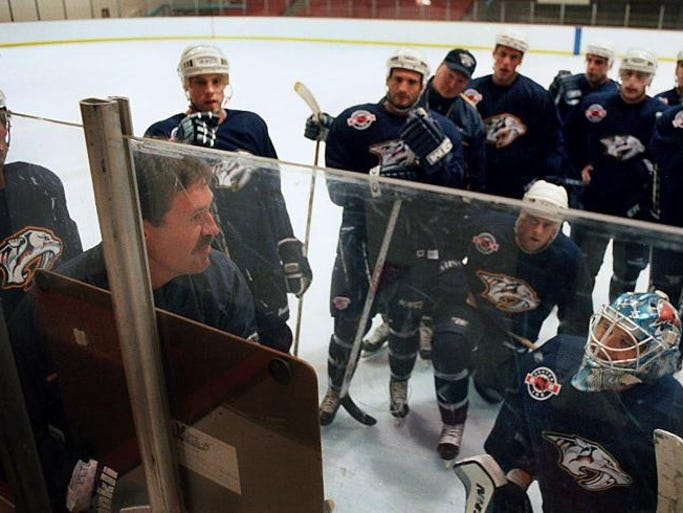 Nashville Predators assistant coach Paul Gardner, left, discusses some play options during a practice session at Centennial Sportsplex Sept. 13, 2001.
