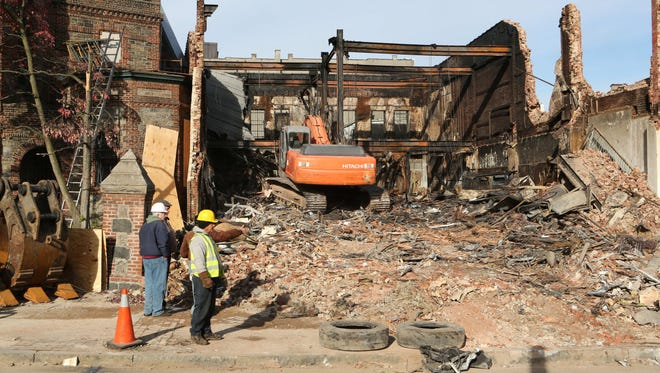 Workers with Capital Demolition and Carting from Yonkers, take down one of the buildings in Getty Square Oct. 27, 2015, five days after a multi-alarm fire.