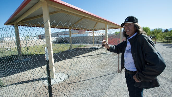 James Sassak, chief operational member of Camp Hope, shows the new shower facility that is under construction at the camp on Friday March 25, 2016.