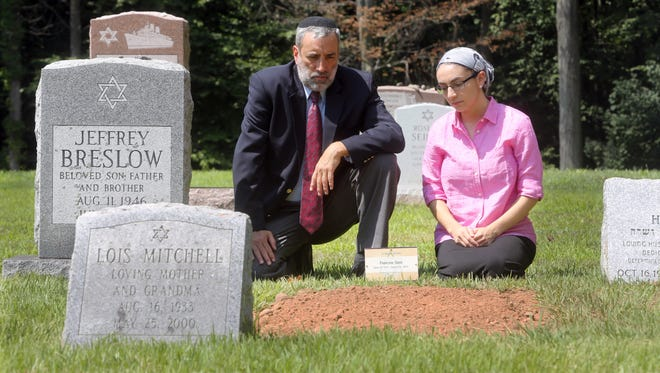 Rabbi Elchanan Weinbach and his daughter Ora, 25, spend time at the grave of Francine Stein at Temple Israel Memorial Park in Blauvelt Aug. 19, 2016. When Rabbi Weinbach, the rabbi at Congregation Shaarey Israel in Montebello, who was to preside over the burial, told his daughter of the situation, Ora reached out on Facebook asking people to attend the funeral, which took place this past Wednesday. Close to thirty people, none of whom knew the deceased, ended up attending.