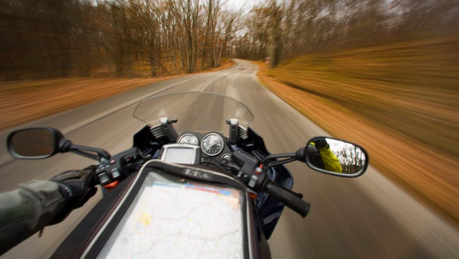 A motorcyclist cruises the Northern Kettle Moraine Scenic Drive on Monday. Blessed with warm weather into November, and a competitive sales market, motorcyclists are riding longer and buying more bikes this fall.