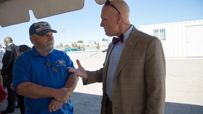 Louis Theriot, left, an Air Force veteran from Alamogordo, talks with Veterans Affairs El Paso VA Health Care System Director Michael Amaral, before the ground breaking ceremony for the new VA clinic on Del Rey Avenue, Friday 10, 2017.