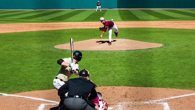 Tyler Holton (14) delivers a strike for the Florida Seminoles on Sat., March. 4 at Mike Martin Field at Dick Howser Statdium in Tallahassee, Fl