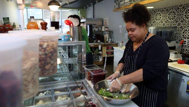 Ihsaana Muhammad prepares a salad for a customer at Got Thyme.