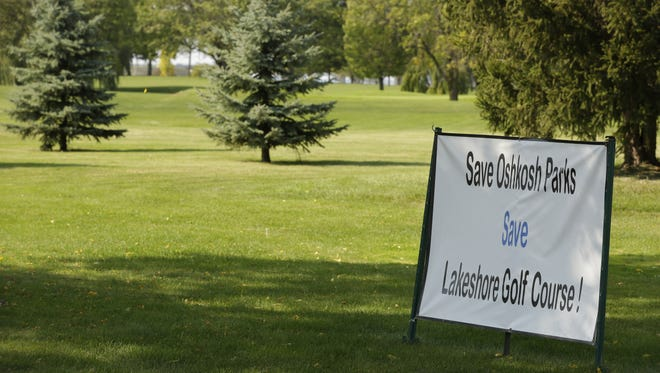 """A sign urges visitors to """"Save Oshkosh Parks: Save Lakeshore Golf Course!"""" on Sept. 15, 2017, at Lakeshore Municipal Golf Course in Oshkosh."""