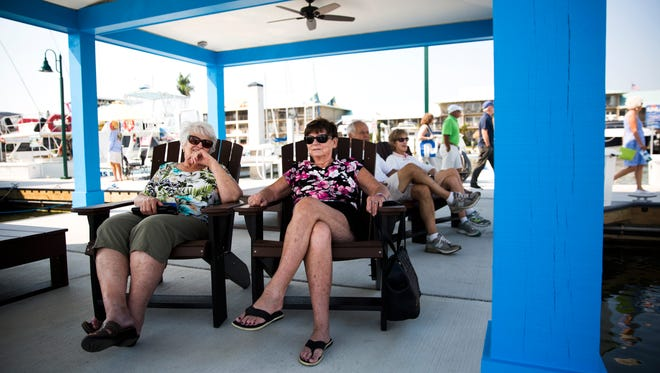 Rosalie Giuffre, left, and Agnes Vautour sit together on the Naples City Dock in Crayton Cove and enjoy watching the birds and boats go by on Monday, March 5, 2018. The dock recently opened to the public after construction.