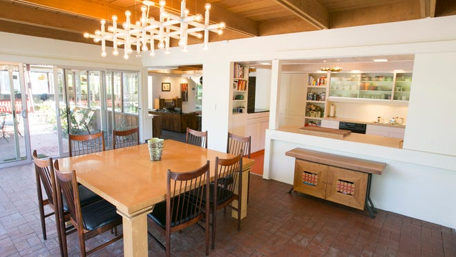 Dining room of the midcentury modern home in Phoenix on March 25, 2016. The home built and lived in by architect Fred Guirey in the 1940s was rescued and restored by the Bill and Bo Mostow who live there with their four children.