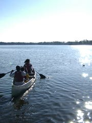 Campers canoe at YMCA Camp Chandler.