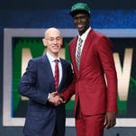 Thon Maker greets NBA commissioner Adam Silver after being selected as the number ten overall pick to the Milwaukee Bucks in the first round of the 2016 NBA Draft at Barclays Center.