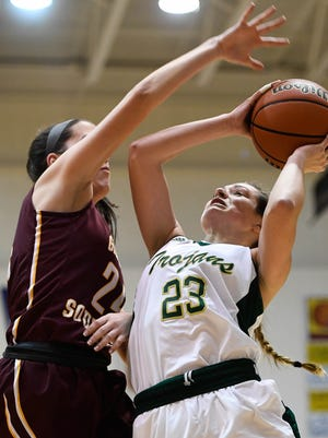Wood Memorial's Chloe Bartley puts up a shot against Gibson Southern's Sophie Toth during the  Lady Trojans' 73-67 win over the Titans in  the Toyota Classic championship game on Dec. 23, 2016 at Gibson Southern. On Saturday Wood Memorial will attempt to win the Class A state championship.
