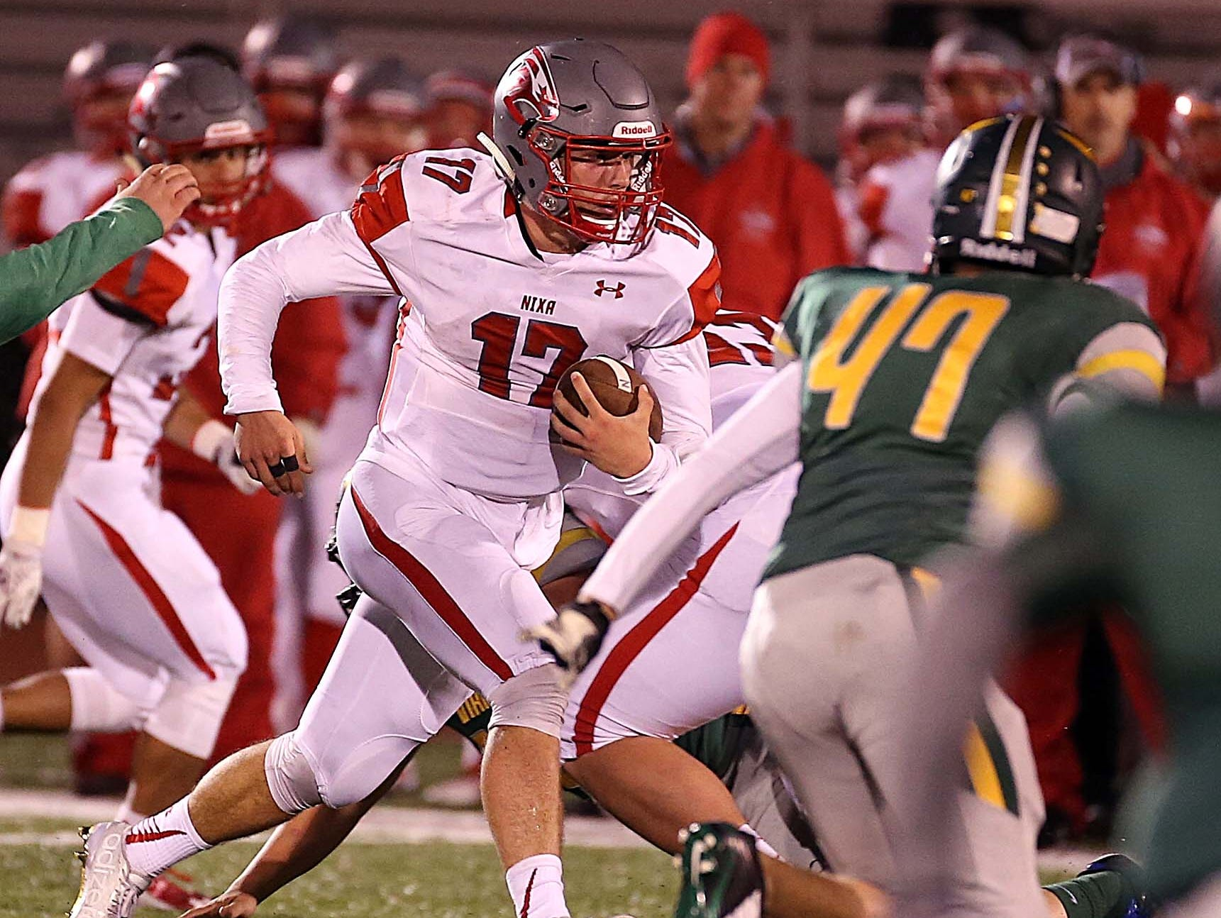 Nixa's Logan Tyler gains a first down during his team's visit to Parkview on October 30, 2015.