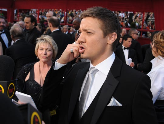 That woman behind Jeremy Renner? His rep, Susan Patricola.