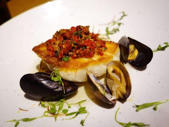 Sea bass and Kauai shrimp with saffron farro risotto, chorizo, charred i'itoi onions and shishito peppers at Lon's at the Hermosa.