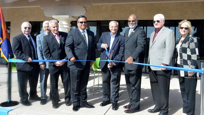 Former U.S. Rep. Harry Mitchell cuts the ribbon to open the East Valley Veterans Education Center in Tempe.