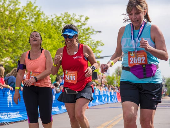 A group of friends cross the finish line of the Colorado