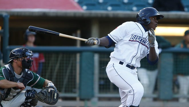 The BlueClaws' Cornelius Randolph hits an RBI single in this season's home opener against the Greensboro Grasshoppers.