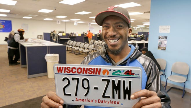 Demetrius Bokes of Milwaukee holds the new license plates he was just issued at the Wisconsin Department of Motor Vehicles' location at N. Teutonia Ave. on Tuesday. More car license plates in Wisconsin have letter combinations starting with X, Y and Z because the state is nearing the end of the alphabet and running out of plate possibilities.