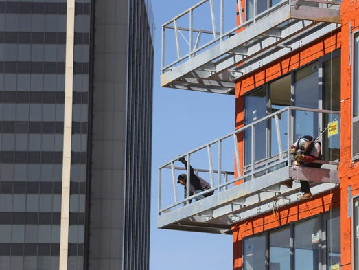Welders Andres Saca, left, and Barry Deliz work on a terrace being constructed at a new apartment building being built at Maple and Dekalb avenues in White Plains April 10, 2014.