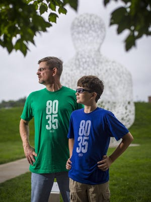 Finn Andersen, 12, right, and his dad, Seth Andersen, organizers of the 80/35 Gen Z stage, pose for a photo at the Pappajohn Sculpture Park in Des Moines.