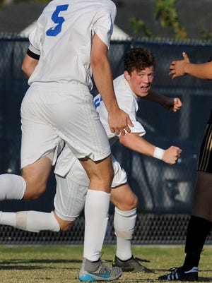 Memorial's Sam Bonano reacts after scoring a goal during the first half last year's sectional  against Jasper at Traylor Family Stadium in Evansville.