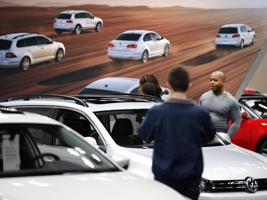 People explore Volkswagon's new offerings at the 2014 Indianapolis Auto Show. America's second-longest running auto show runs through Jan. 1, 2014.