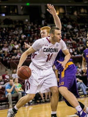 In this Nov 27, 2015 photo, South Carolina forward Laimonas Chatkevicius (14) drives around Lipscomb Bisons center David Wishon (33). Chatkevicius will participate in the Gotham Hoops Invitational, Saturday, at St. Francis College in Brooklyn, New York.