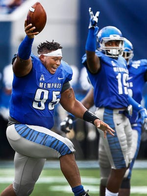 Memphis defender Michael Edwards (95) celebrates a fumble recovery against Kansas during the second quarter Saturday at the Liberty Bowl.