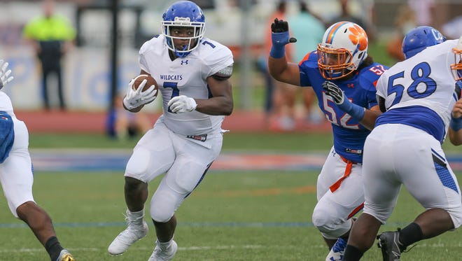 Meridian running back Antoine Martin (7) finds a hole in the Madison Central defense in the first quarter as Madison Central's Zachary Causey (52) tries to break free from a block. Madison Central and Meridian played in the 2016 football season-opener at Madison Central on Friday, August 19, 2016. Photo by Keith Warren