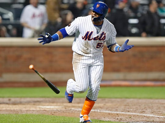 New York Mets' Yoenis Cespedes looks toward the Mets'