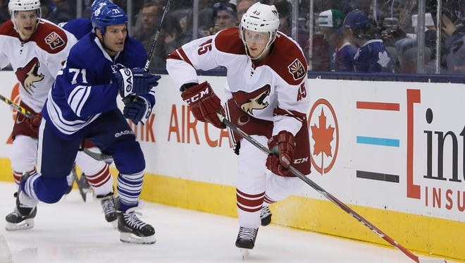Jan 29, 2015: Arizona Coyotes defenseman Andrew Campbell (45) goes to pass the puck as Toronto Maple Leafs forward David Clarkson (71) chases during the first period at the Air Canada Centre.