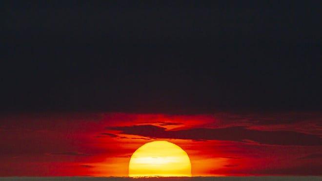 Sunrise off Midtown Beach in Palm Beach Monday, July 6, 2020.