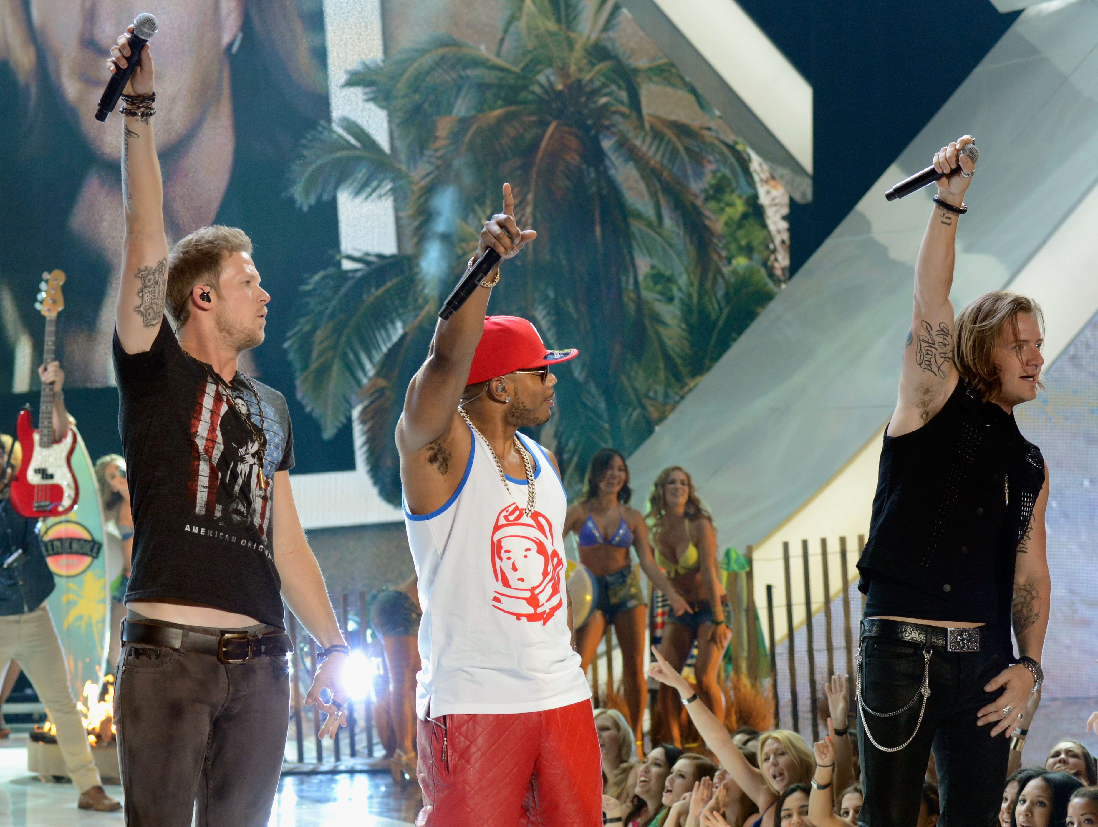 Recording artists Nelly and Florida Georgia Line members Brian Kelley and Tyler Hubbard perform.